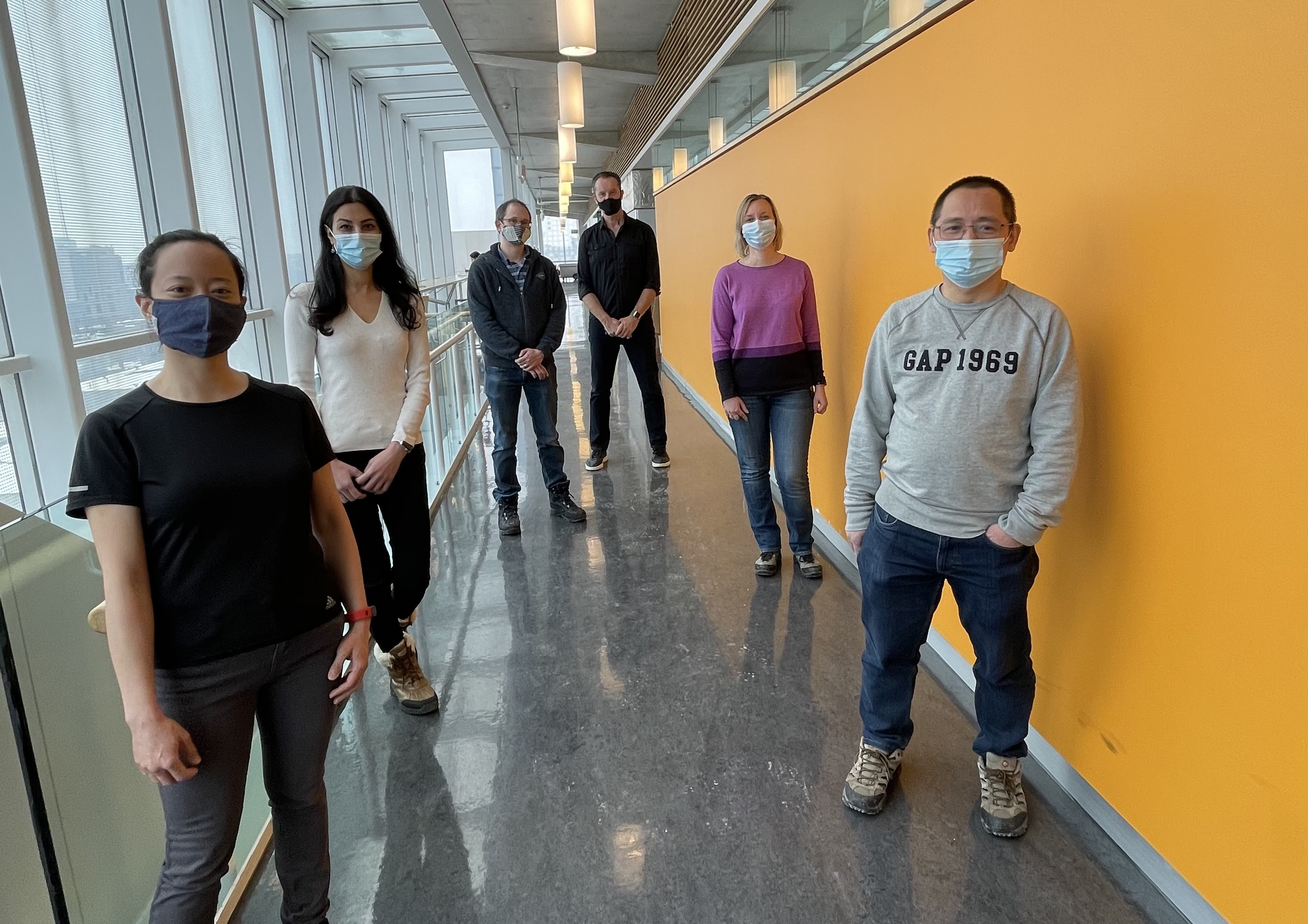 Stagljar lab members standing physically distanced outside their lab